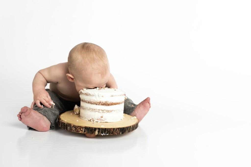 Baby eating cake, greed